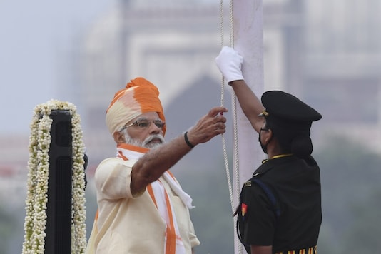 Prime Minister Narendra Modi unfurls the tricolour during a ceremony to celebrate India's 74th Independence Day, at the Red Fort in Delhi on August 15, 2020. (AFP)