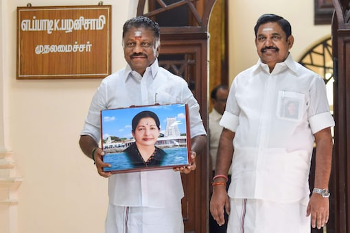 Loyalists of Tamil Nadu CM E Palaniswami (right) and deputy chief minister O Panneerselvam are going all out to project their leaders as the CM candidate. (File photo/PTI)