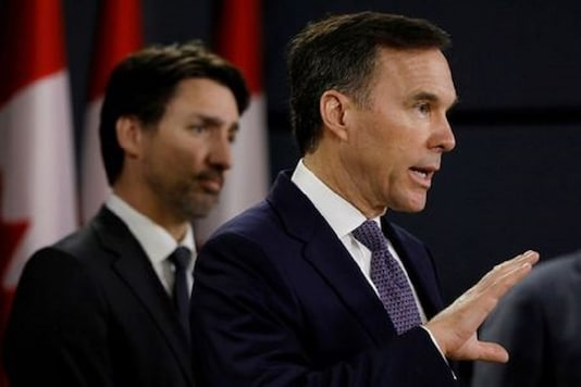 Canada's Minister of Finance Bill Morneau attends a news conference with Prime Minister Justin Trudeau in Ottawa, Ontario, Canada. (Reuters)