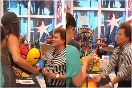 Screenshot of video showing the restaurant owner yelling at the artist and breaking his artwork.