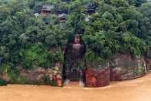 Flood Waters Reach the Toes of China's Famous Giant Buddha Statue for the First Time in 7 Decades