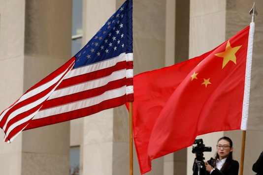U.S. and Chinese flags are seen before Defense Secretary James Mattis welcomes Chinese Minister of National Defense Gen. Wei Fenghe to the Pentagon in Arlington, Virginia, U.S., November 9, 2018. REUTERS/Yuri Gripas/Files