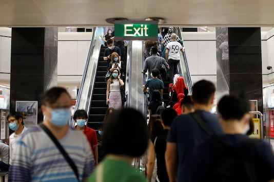 Commuters wearing protective face masks leave a train station during the coronavirus disease (COVID-19) outbreak in Singapore August 17, 2020.  (REUTERS)