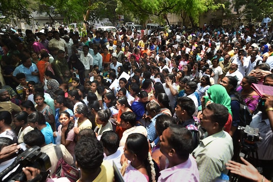 In this May 5, 2019 file photo, candidates wait outside an examination centre to appear in the National Eligibility-Cum-Entrance Test (NEET) exams in Chennai. (PTI)