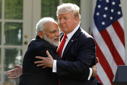 India's Prime Minister Narendra Modi hugs U.S. President Donald Trump as they give joint statements in the Rose Garden of the White House in Washington, U.S., June 26, 2017. REUTERS/Kevin Lamarque/File Photo