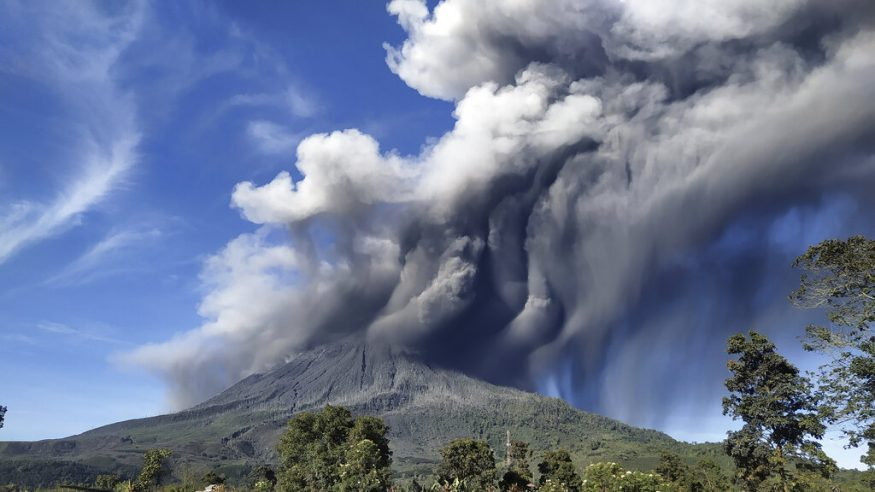 A rumbling volcano in Indonesia unleashed an avalanche of scorching clouds down its slopes. In this photo, Mount Sinabung is seen spewing volcanic materials during an eruption, in Karo, North Sumatra. (Image: AP)