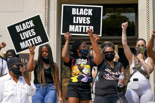 A small group of Black Lives Matter protesters hold a rally on the steps of the Kenosha County courthouse Monday, Aug. 24, 2020, in Kenosha, Wis. Kenosha police shot a man Sunday evening, setting off unrest in the city after a video appeared to show the officer firing several shots at close range into the man's back. (AP Photo/Morry Gash)