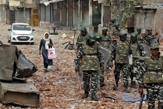Security forces patrolling a street in New Delhi after the riots in February. (Reuters)