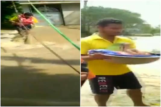 The video showed the personnel clinging by rope as they rescued people.
