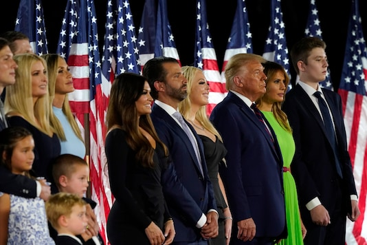 From left, Jared Kushner and his wife Ivanka Trump, Eric and Lara Trump, Kimberly Guilfoyle and Donald Trump Jr., Tiffany Trump, President Donald Trump and first lady Melania Trump, and Barron Trump stand on stage at the Republican National Convention, on August 27, 2020. (AP Photo/Alex Brandon)