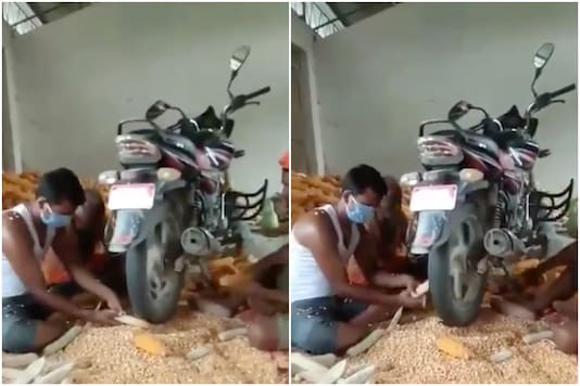 Anand Mahindra was impressed by a video of men using a bike to separate corn from cob   Image credit: Twitter