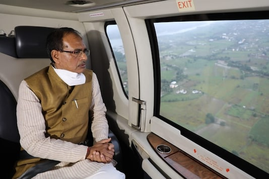 Madhya Pradesh Chief Minister Shivraj Singh Chouhan conducts aerial survey of flood-affected areas in Hoshangabad district. (Image: Twitter/ANI)