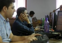 Sensex, Nifty settle higher after RBI keeps rate steady