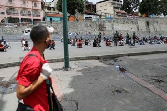 Venezuelans breaking coronavirus rules punished under the sun
