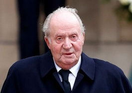 Most Spaniards think ex-King Juan Carlos should not have left, opinion poll finds