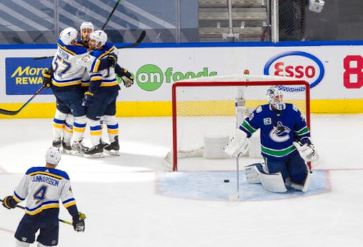 O'Reilly scores 2, Blues beat Canucks 3-1 to tie series