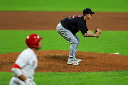 Indians place 2 pitchers on restricted list after violations
