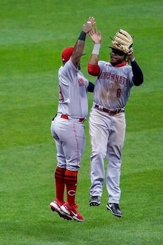Bauer strikes out 12 as Reds defeat Brewers 8-3