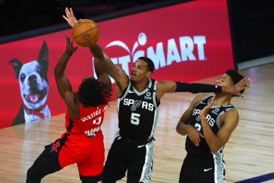 Spurs beat Rockets 123-105 to stay alive in playoff race