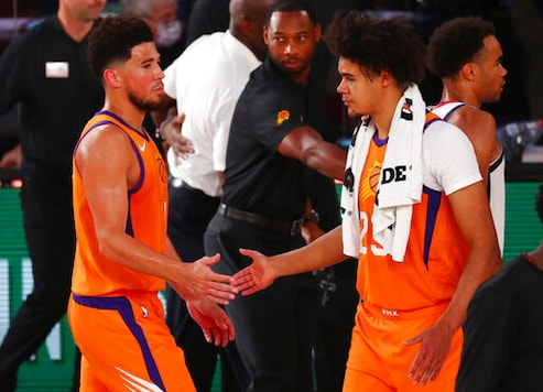 Booker scores 27 points, Suns beat Wizards 125-112 in return