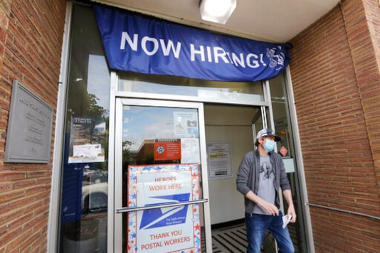 US employers post more jobs in June, pull back on hiring