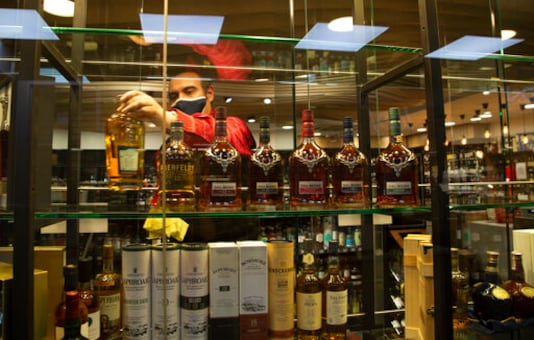 South Africa opens as virus cases fall, allows liquor sales