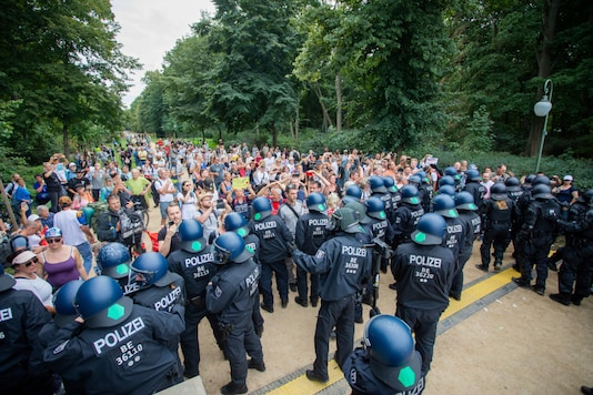 Policemen push people into the Tiergarten in a protest against the coronavirus measures in Berlin, Germany, on August 30, 2020 (Christoph Soeder/dpa via AP)