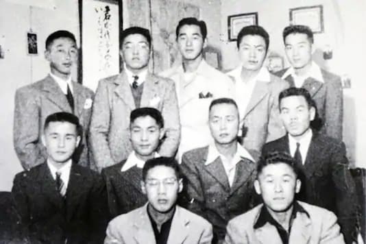 n this 1944 photo provided by Hidekazu Tamura, Tamura, second from right in center row, poses with his youth league group at Tule Lake concentration camp at southeast of Phoenix during the pacific war period. Hidekazu Tamura via AP