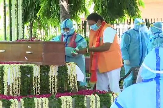 he last rites of former President Pranab Mukherjee being performed at Lodhi crematorium, by his son Abhijit Mukherjee