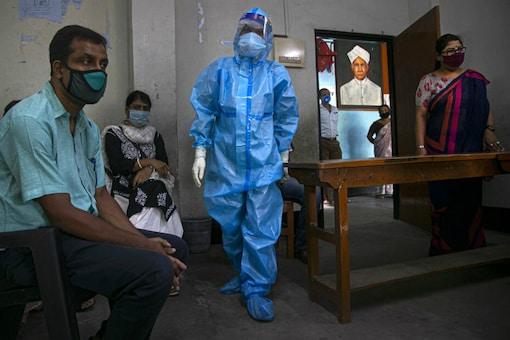 A health worker prepares to take nasal swabs of teachers before schools reopen in Guwahati. (AP)
