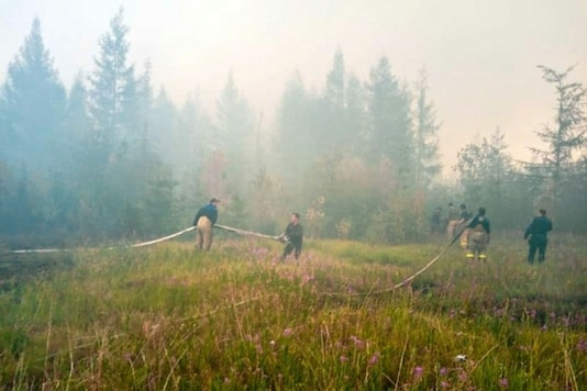 Uncontrolled forest fires across eastern Russia have sent more than half a billion tonnes of CO2 spiralling into the atmosphere since January, a record. Credit: AFP
