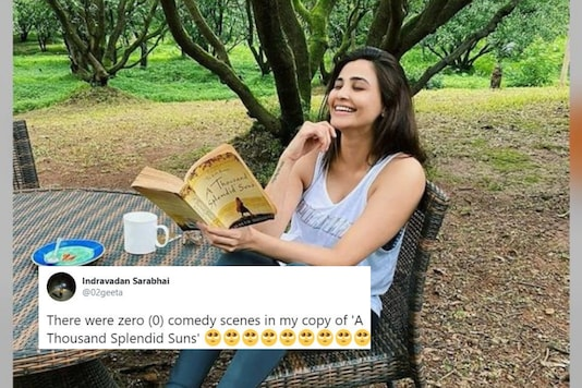 Daisy Shah while posing with the book.