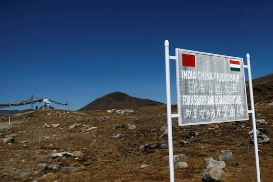 A signboard is seen from the Indian side of the Indo-China border at Bumla, in the northeastern state of Arunachal Pradesh, on November 11, 2009. (REUTERS/Adnan Abidi/File Photo)