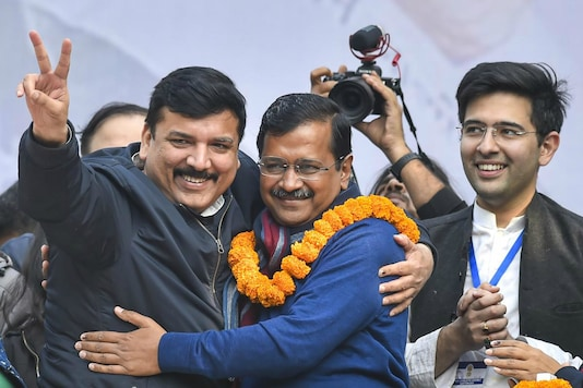 Delhi CM and AAP convenor Arvind Kejriwal hugs party leader Sanjay Singh during his address to supporters after party's victory in the State Assembly polls, at AAP office in New Delhi on Februrary 11, 2020. (PTI/File  Photo)