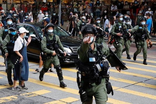 File photo of riot police chasing pro-democracy protesters during a demonstration in Hong Kong. (Reuters)