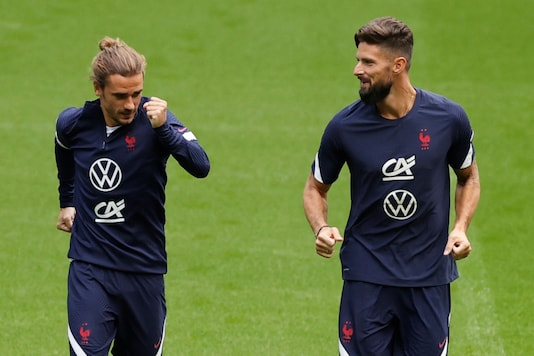 France's Antoine Griezmann, left, and Olivier Giroud attend a training session ahead of the UEFA Nations League soccer match between France and Croatia at the Stade de France stadium in Saint Denis, north of Paris, Sunday Sept. 6, 2020. (Christian Hartmann/Pool image via AP)