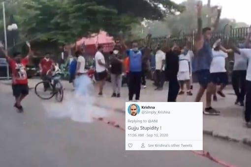 Video grab of joggers bursting crackers in Vadodara, Gujarat. (ANI)