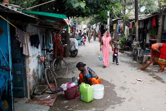 A woman washes clothes outside her house at a slum in New Delhi. (Image: Reuters/File)