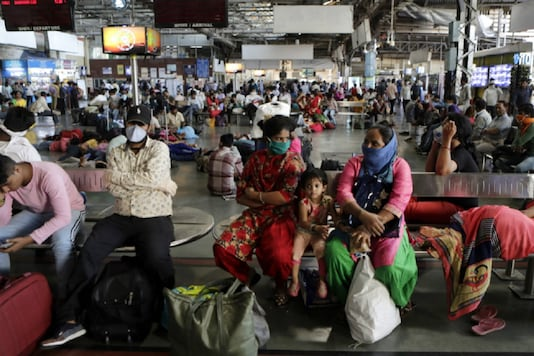File photo of passengers waiting at a railway station.
