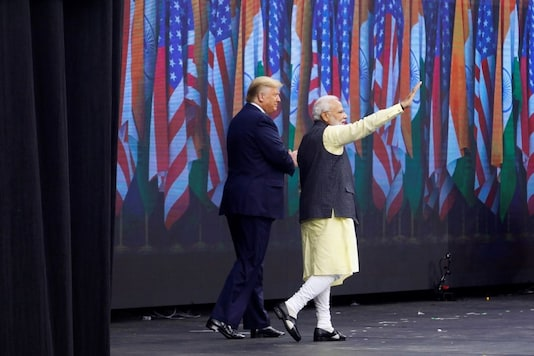 "U.S. President Donald Trump and Indian Prime Minister Narendra Modi take the stage during a ""Howdy, Modi"" rally celebration at NRG Stadium in Houston, Texas, U.S. September 22, 2019. REUTERS/Daniel Kramer"