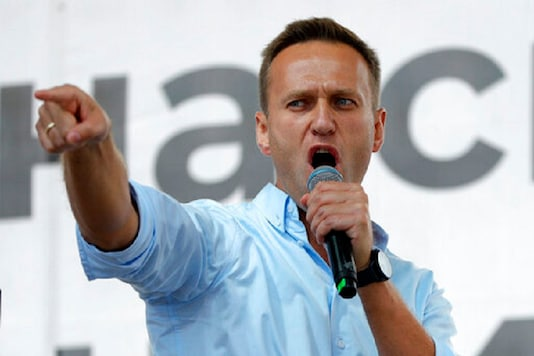 Russian opposition activist Alexei Navalny gestures while speaking to a crowd during a political protest in Moscow, Russia. (AP Photo)