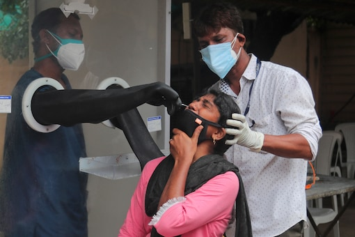 Health workers collect a nasal swab sample to test for Covid-19 in Hyderabad, on September 17, 2020. (AP Photo/Mahesh Kumar A.)