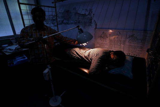 A woman receives therapy treatment inside a training centre for disabled people in Ahmedabad. (Image: Reuters)