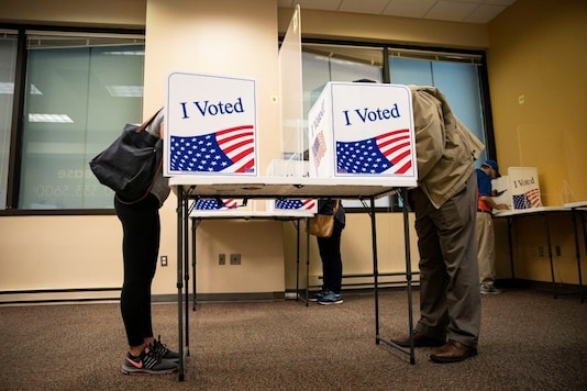 People fill out their ballots at an early voting site in Arlington, Virginia, U.S., September 18, 2020. REUTERS/Al Drago