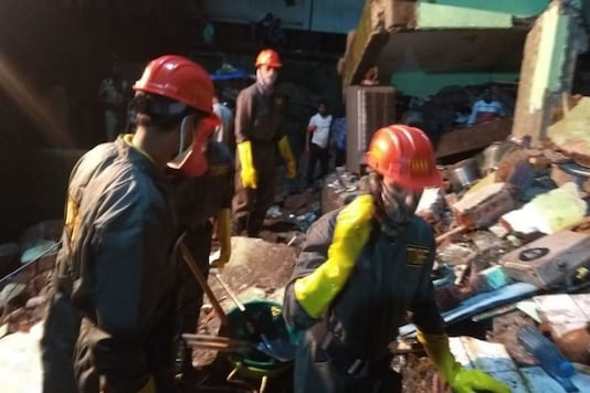 NDRF officials said 20 people have been rescued by locals and at least 20-25 people are feared to be trapped. (Photo:ANI)