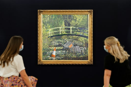 Banksy's 'Show Me the Monet' is expected to fetch between three and five million pounds (3.9 - 6.5 million dollars) at the Sotheby's 'Modernités / Contemporary' sale. (AFP)