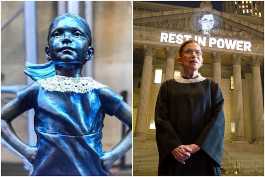 New York's Fearless Girl statue just donned a collar as a tribute to the original fearless girl, Justice Ruth Bader Ginsburg | Image credit: Twitter/Reuters
