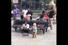 WATCH: Toddler Joins Group of Street Musicians With Toy Trumpet and the Internet is in Awe