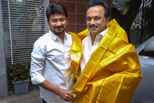 Actor Udhayanidhi Stalin poses with father and DMK president MK Stalin after being appointed the party's youth wing secretary, in Chennai on July 4, 2019. (PTI Photo)
