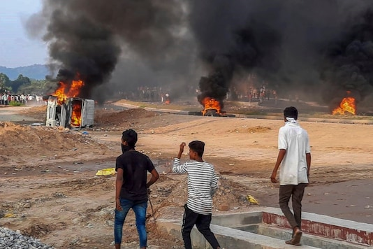 Vehicles and tires are torched during a protest demanding recruitment of reserved category candidates on vacant unreserved positions for teachers, in Kakari Dungri village of Rajasthan's Dungarpur district, on September 25, 2020. (PTI Photo)